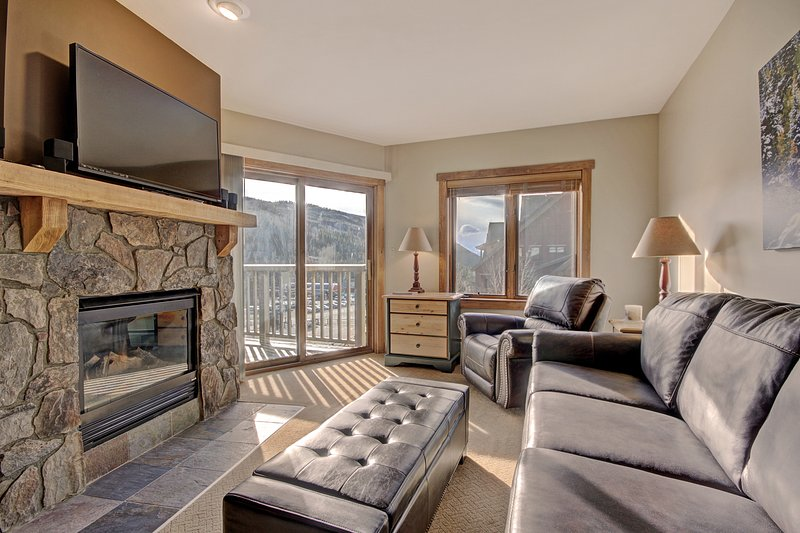SkyRun Property - '2298 Red Hawk Lodge' - Living Room - Spacious living room allows for a lot natural light to come in.