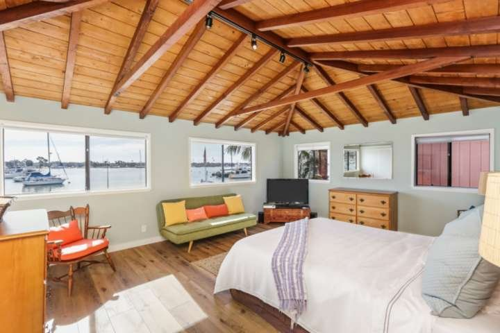The unique master bedroom offers amazing views of the harbor while providing a private retreat from the rest of the house and a place to relax.