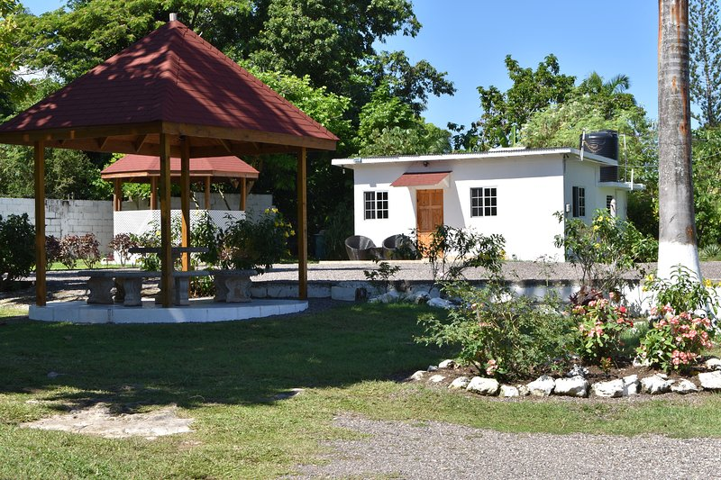 View our beautiful indigenous gardens where we have beautiful flowers also various fruit trees.