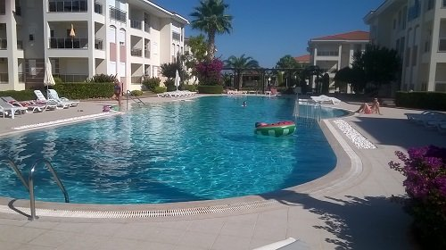 The main pool with pool side bar at one end. Great safe gated community