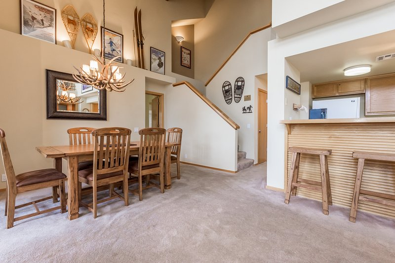 Dining area and stairs to loft