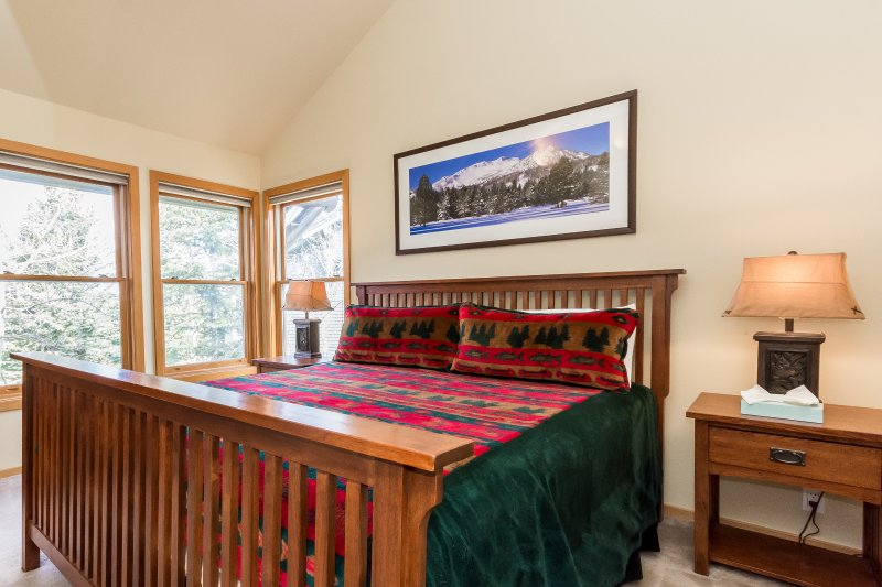 Master Bedroom with king bed & master bath ensuite and flat screen TV