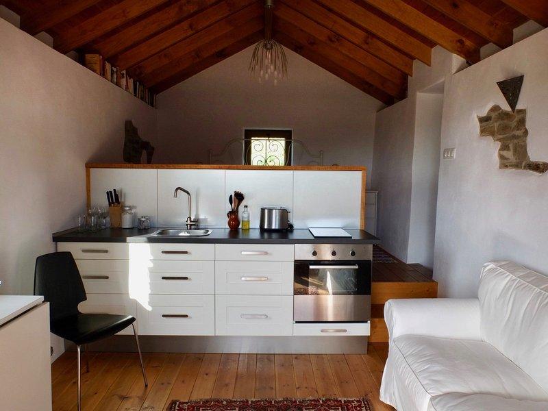 Cuisine et salle de séjour de Casa Sofia.