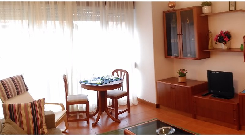 Living room with extendable table for four. Partial bay views.