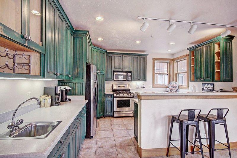 Küche - Frühstück Bar bietet Platz für bis zu zwei Personen.