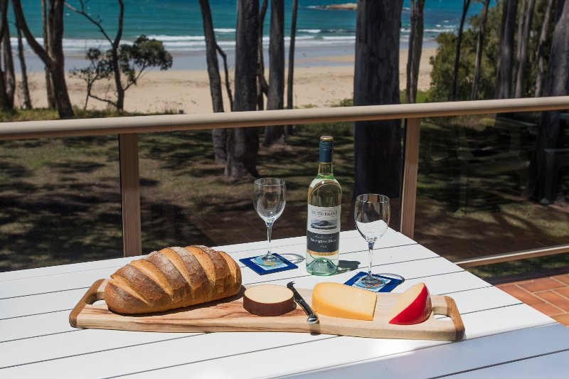 Alfresco dining on the balcony, as you overlook the beach