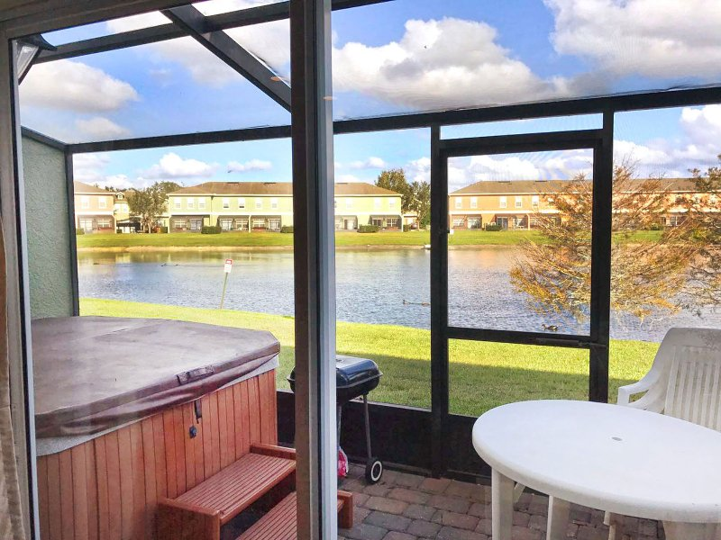 screened patio with private hot tub and lake view