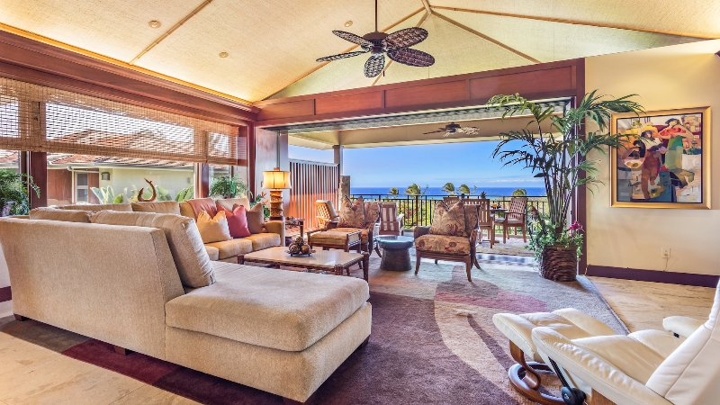 Spacious Living Area w/Vaulted Ceilings, Pocket Doors to Lanai, and Epic Ocean View.