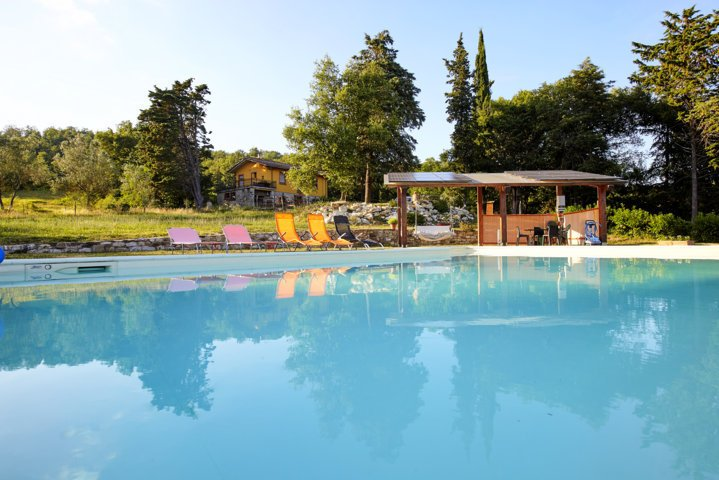 view of the pool and the house