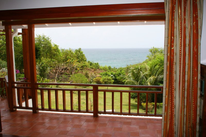 The Master bedroom balcony and view of the garden and ocean.