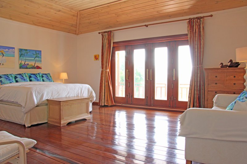 Master bedroom :- featuring large double doors which open onto a balcony with garden and ocean views