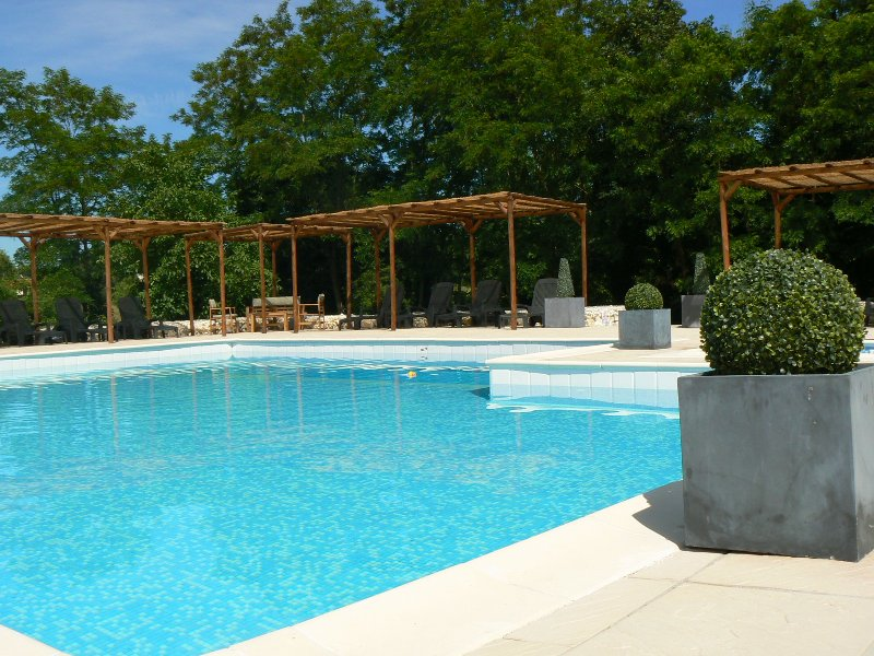 Large pool with wrap around sun terrace under shaded pergola's and toddlers splash pool
