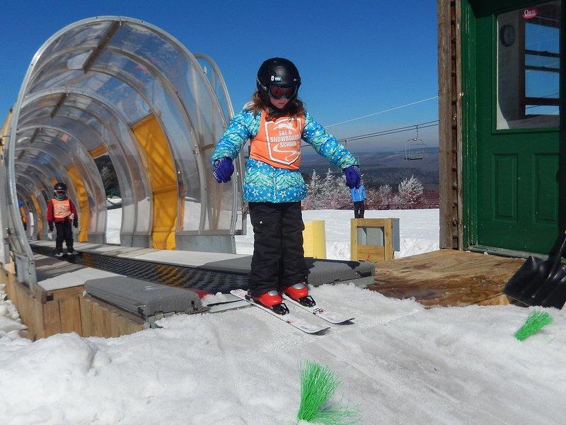 Put the kids in ski or snowboard school.
