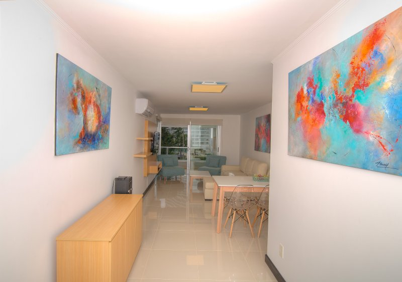View of the entrance of the apartment. The pictures are of the artist Nelly Malel.