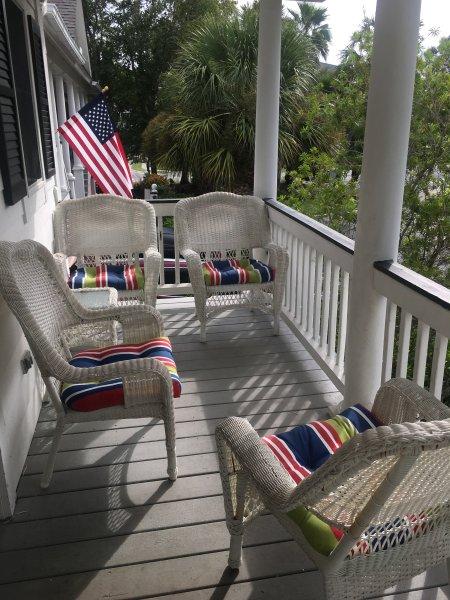 Front porch seats four