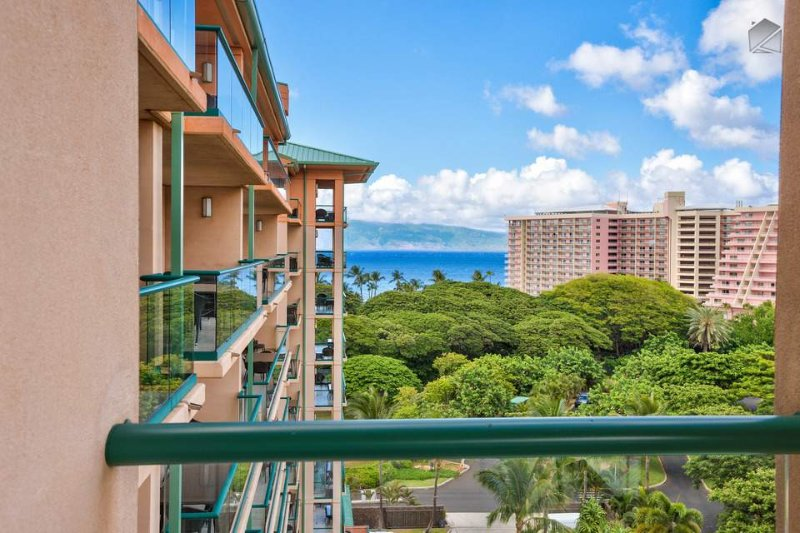 Look out over the verdant canopy to the sea from the comfort of your lanai