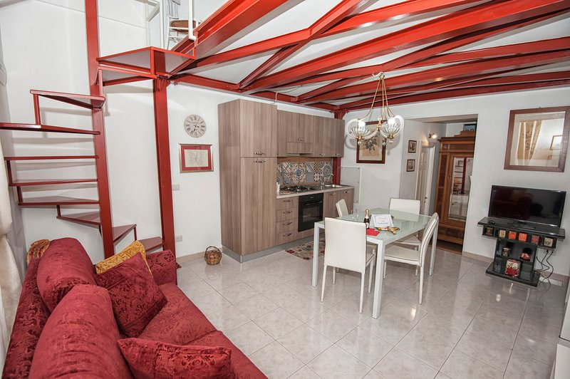 The living area is equipped with a compete kitchen, a dining area and a comfortable sofa bed.