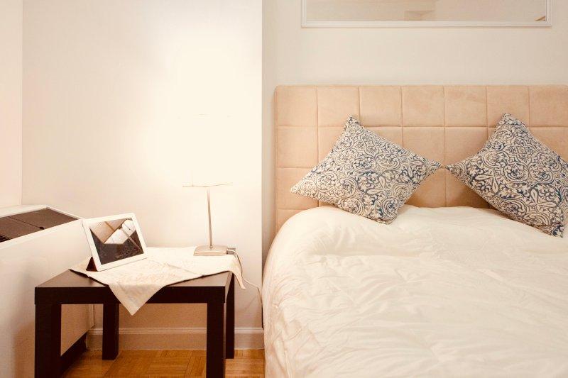 Queen bed may sleep 2