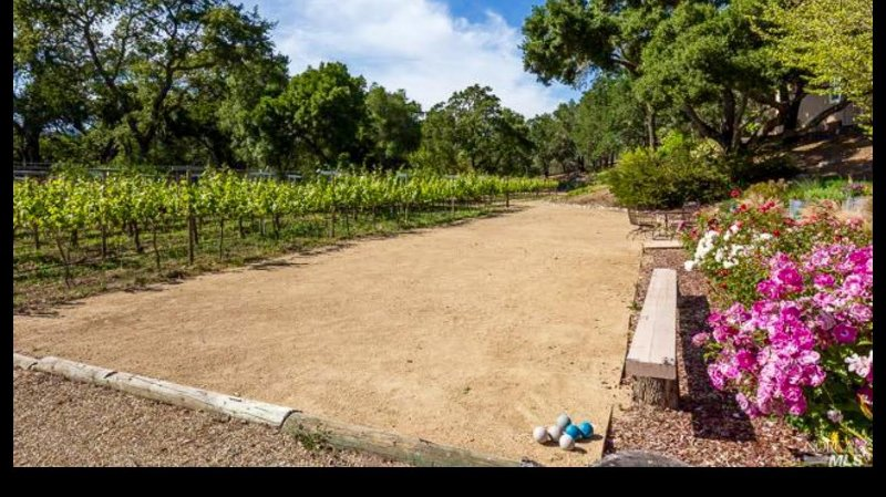 Vineyard Bocce court with fire pit (not shown) Bocce balls are provided. Rose Garden to the right.