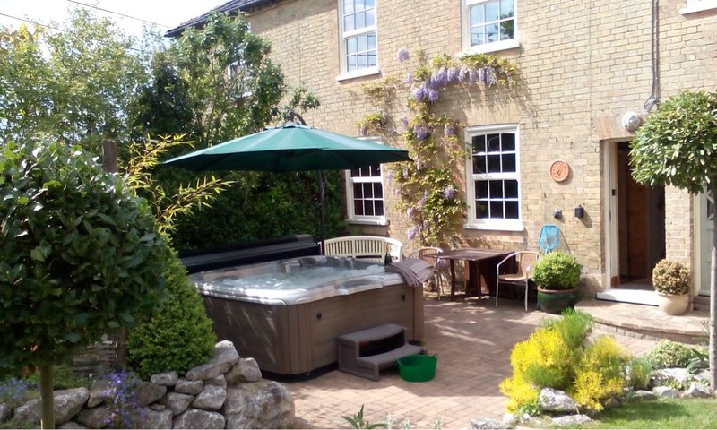 Relax in the hot tub in the south facing garden and patio.