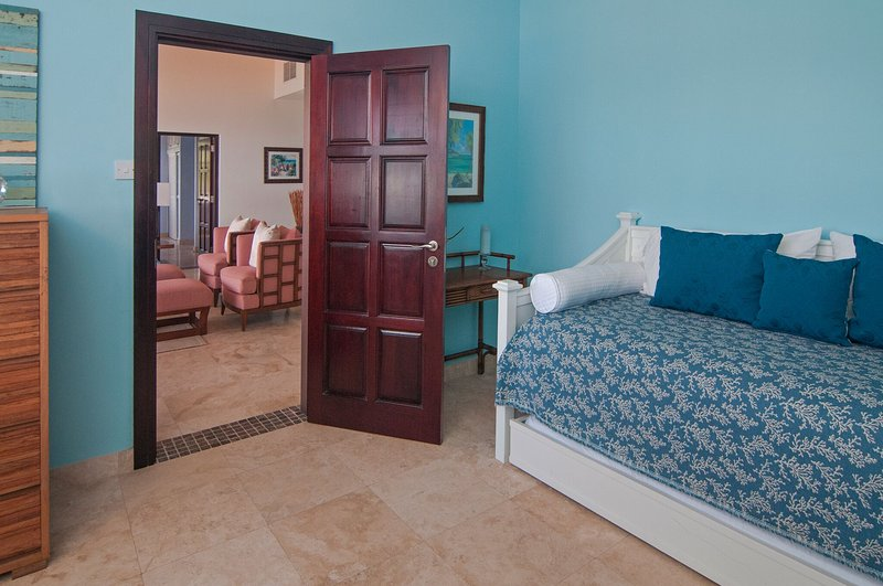 Separate room off of Bedroom 2 with daybed and designated shower room across the hall