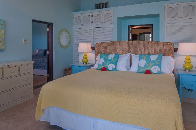 Bedroom 2 has sliding doors that open onto the beautiful upper veranda