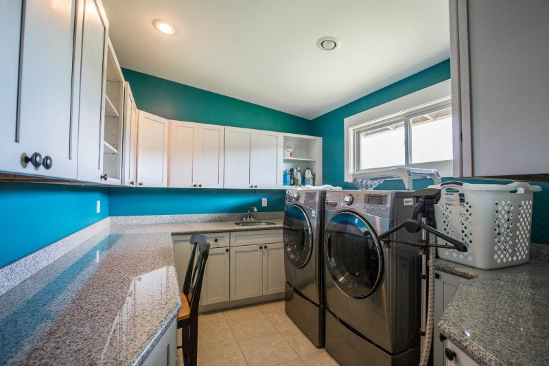 Large laundry room with state of the art washing machine and dryer.
