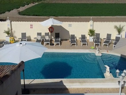 View Of Swimming Pool and sun terrace.