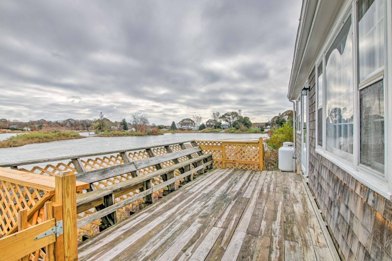 Runaway to cool coastal vibes at this waterfront vacation rental cottage!