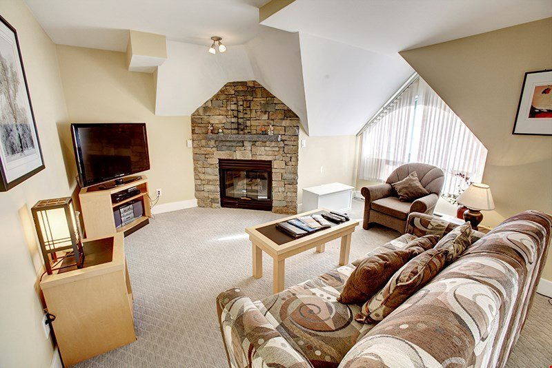 Relax and unwind in the spacious living area, complete with a fireplace.