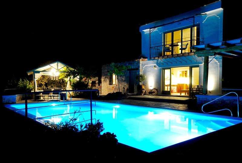 A view of the villa from the terrace , large pool ,smaller heated spa pool on a lower level