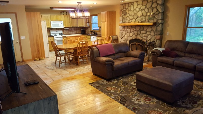 kitchen, eating area, and living area with natural fireplace