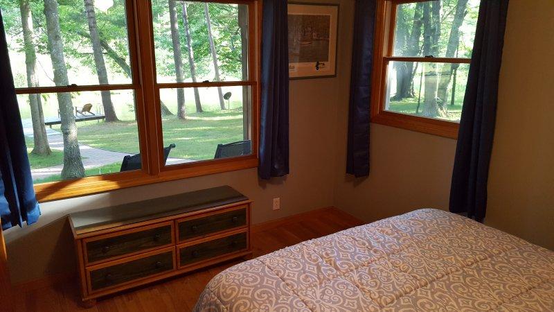 main floor bedroom (river side) 1 queen bed