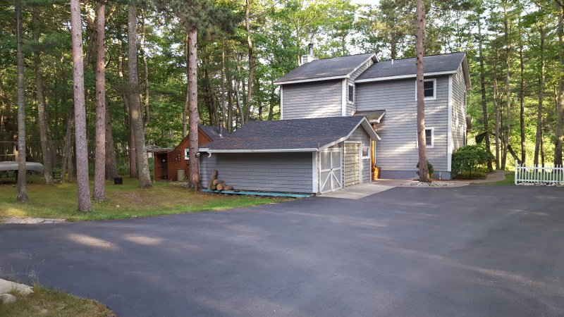 parking, house, pool table room, kayak shed, sauna view and basketball hoop (not visible)