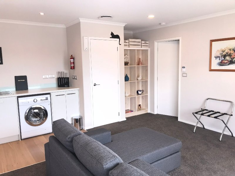 Comfortable living space through to separate bedroom with en-suite.