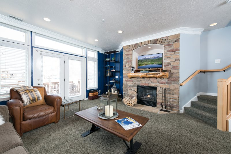 Main living room with Snowbasin views and fireplace