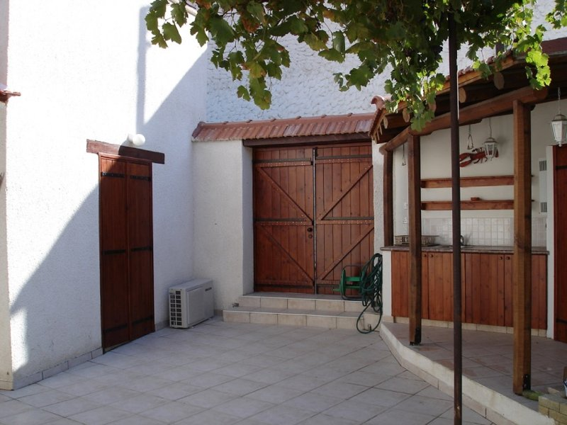 Traditional large detached village house wih private pool and enclosed courtyard, holiday rental in Lythrodontas