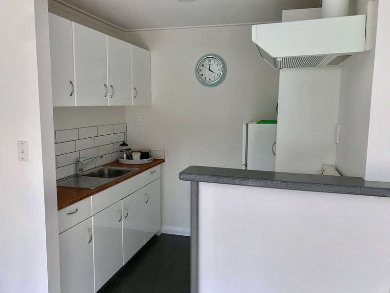 Fully equipped kitchen with fridge/freezer, stove and microwave.