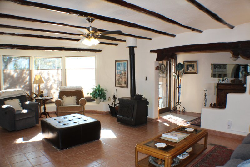 Plenty of room in the living area.  Wood burning stove, tile floors and comfortable seating.