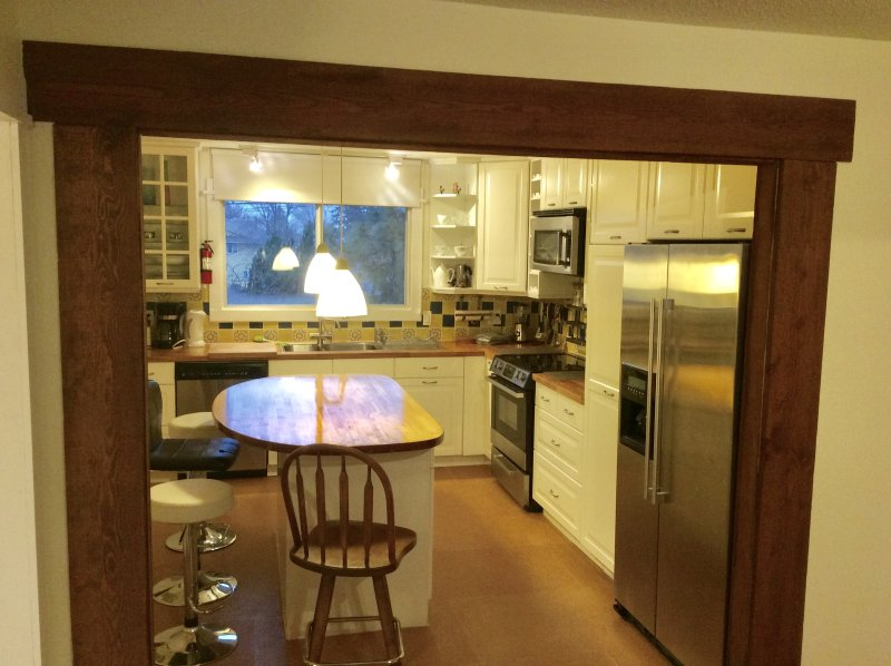 Eat in kitchen with stainless steel appliances and centre island
