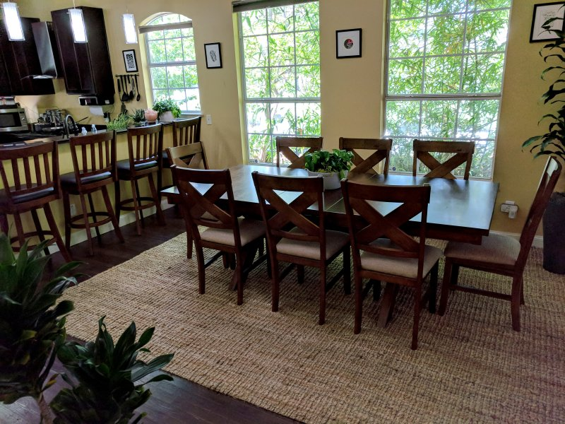 Extra-large dining table with 8 chairs and 4 barstools with ample counter space.