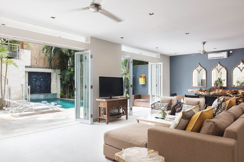 Seamless indoor/outdoor living, with folding doors that can be closed for air-conditioned comfort.