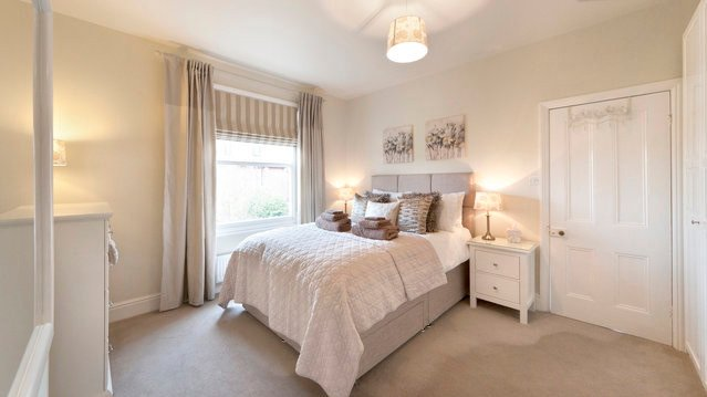 Bedroom with king sized bed, memory foam mattress topper and 100% cotton linen