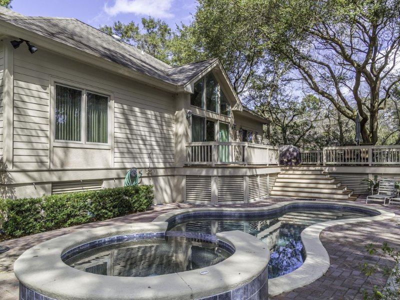 Great private back yard with deck/table grill and view of lagoon