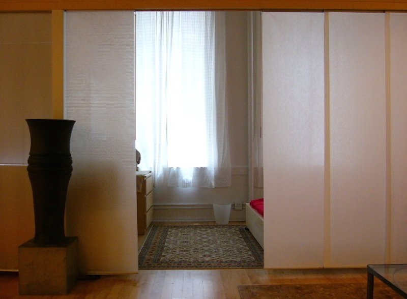 sleeping area with queen bed/ dividers open