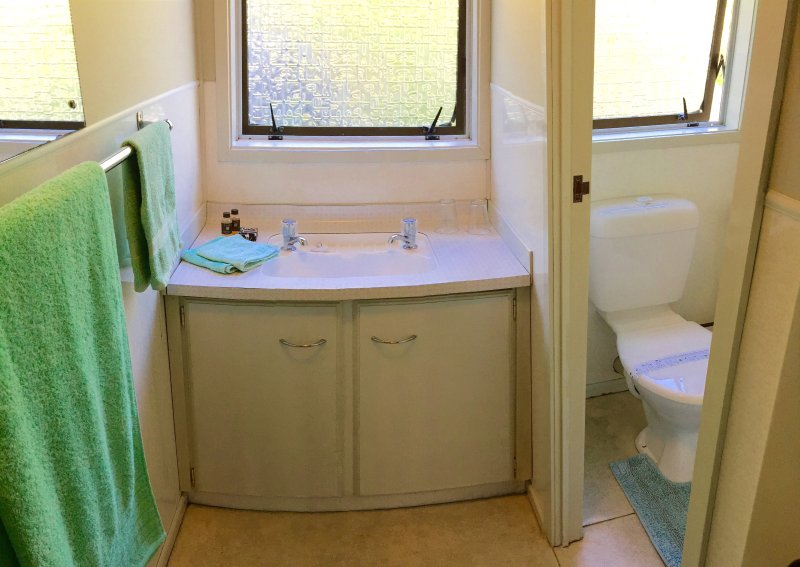 Bathroom with Shower, Washbasin, Toilet. Toiletries and towels are provided.