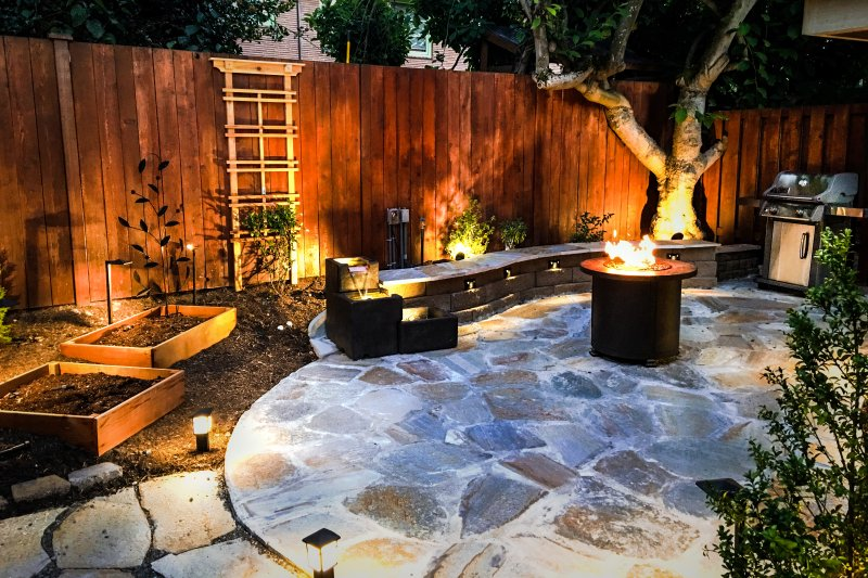Heavenly private patio with grill, firepit, and a soothing water fountain.