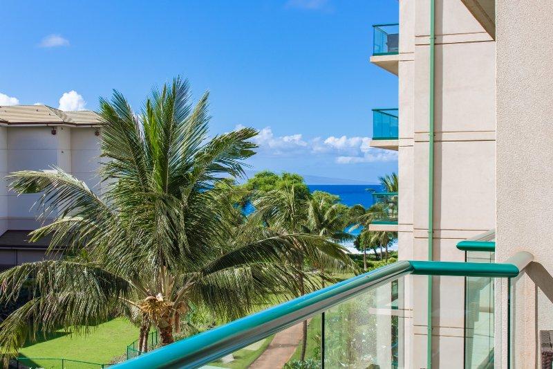 A spacious 1 bedroom suite with partial ocean views