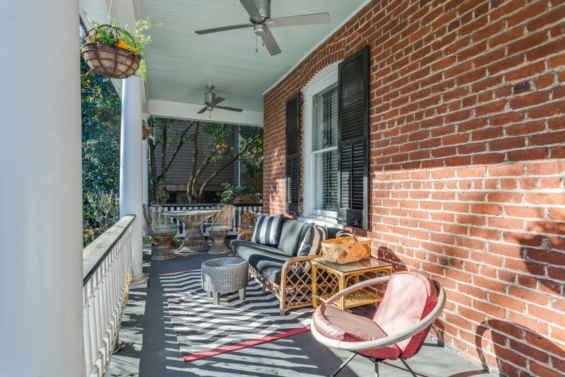 Enjoy pedestrian watching and private evenings on your front porch with minutes to the Mall