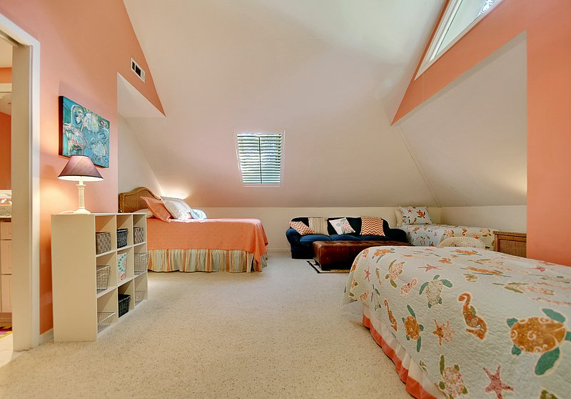 second upstairs bedroom has one queen bed and two twin beds